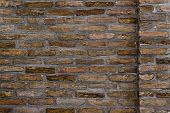 picture of brick block  - Horizontal background pattern of weathered old brick wall texture grungy rusty brushed blocks as urban architecture backdrop - JPG