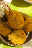foto of pooja  - Top View of Coconuts with turmeric on upanayanam ceremony function - JPG