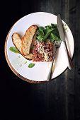 stock photo of tartar  - Tuna tartare and croutons on a dark background  - JPG
