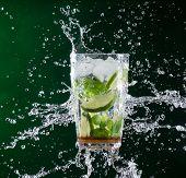foto of freezing  - fresh mojito drink with liquid splash - JPG