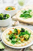 picture of chickpea  - vegan tortilla with roasted broccoli and chickpeas and avocado sauce - JPG
