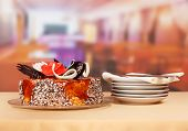 foto of dessert plate  - Dessert chocolate cake with plates and cutlery - JPG