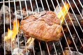image of flame-grilled  - Grilled pork chop on the flaming grill - JPG