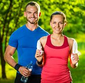stock photo of exercise  - Athletic man and woman after fitness exercise - JPG