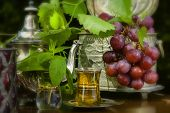 pic of arabian  - Mint tea and red grapes on Arabian table in the garden - JPG