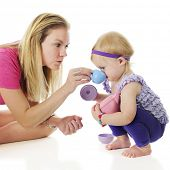 image of squatting  - Mother and daughter playing tea party - JPG