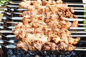 picture of kebab  - skewers with pork shish kebabs on roaster close up - JPG