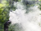 foto of chimney  - gray smoke from the oven chimney outdoors - JPG