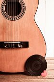image of heart sounds  - An acoustic guitar with a vinyl record and a red love heart - JPG