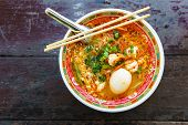 stock photo of egg noodles  - prawn noodles soup with egg in bowl chinese style on wood table - JPG