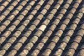 stock photo of unicity  - New white tile in the middle on an old roof - JPG