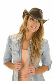 picture of cowgirls  - A cowgirl with her western hat on she has a big smile - JPG