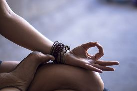 picture of mudra  - Young woman meditating indoors - JPG