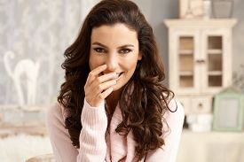 stock photo of shy woman  - Portrait of attractive young woman with a shy smile - JPG