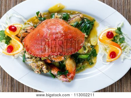 Whole Cooked Dungeness Crab With Green Onion Sauce On White Serving Plate Ready To Eat