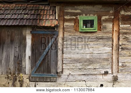 Traditional barn with wooden door and small window