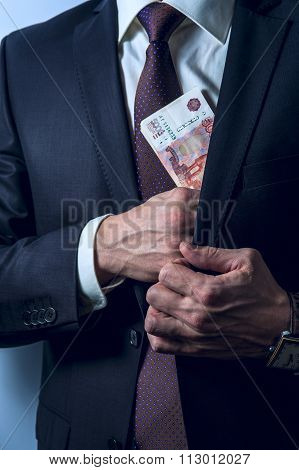 Man removes Russian rubles in his suit pocket