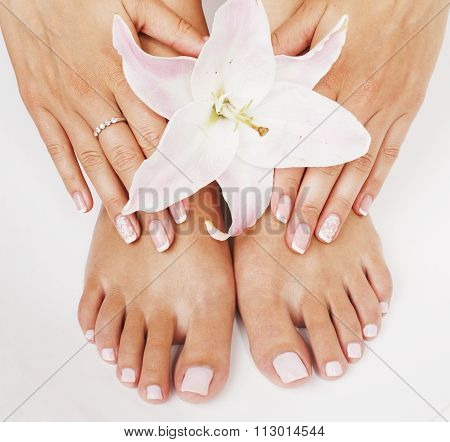 manicure pedicure woman legs with flower lily close up isolated on white perfect shape