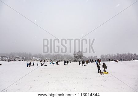 Children Are Skating At A Toboggan Run In Winte
