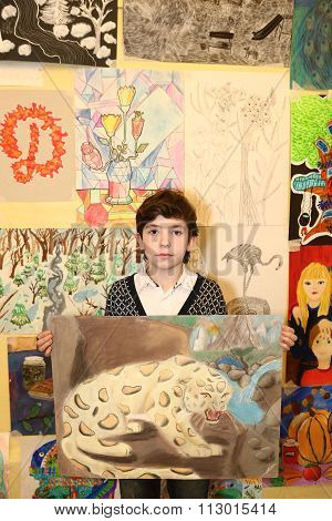 MOSCOW DECEMBER 24 2015: Unidentified art school student boy participate in final painting exhibition at the end of school trimester in Russia Moscow December 24 2015