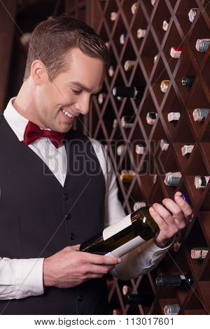Attractive young sommelier is working with joy