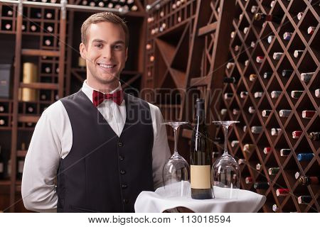 Attractive young sommelier is working in restaurant