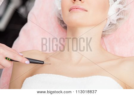 Cheerful young girl is attending beauty salon