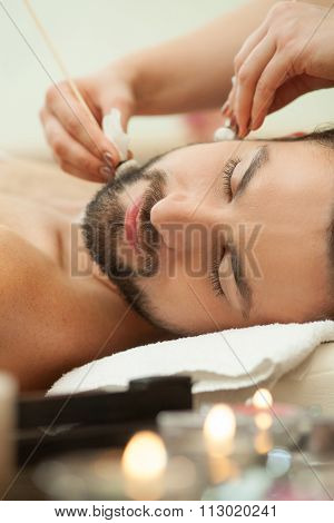 Attractive healthy guy is attending beauty salon