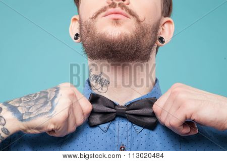 Cheerful young hipster is wearing a tie