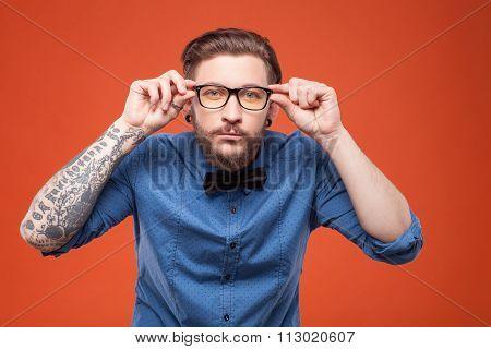 Cheerful bearded man is watching something interesting