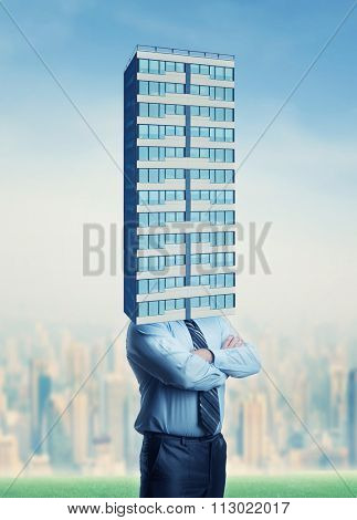 Businessman with high skyscraper instead of head