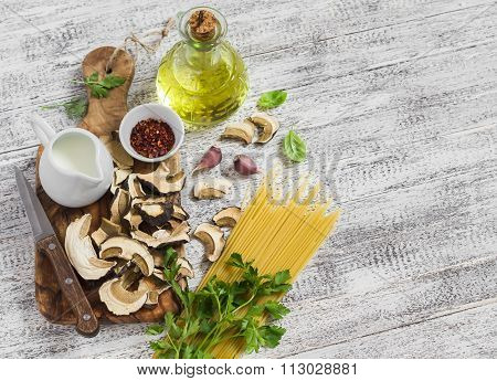 Raw Ingredients For Cooking Pasta With Porcini Mushrooms - Dried Porcini Mushrooms, Spaghetti, Cream