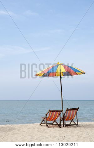 sun loungers and an umbrella on a sunny day
