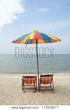 Sun loungers and an umbrella