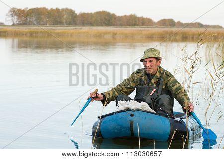 Hunter In A Boat