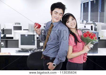 Couple With Flowers And Giftbox