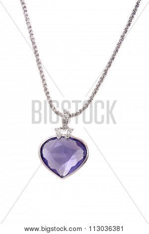 Silver Pendant And Blue Heart Shaped Diamond On White Background
