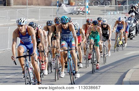 Group Of Male Cycling Triathlon Competitors Fighting