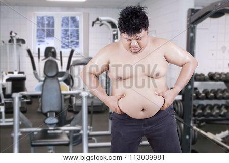 Overweight Man Grabbing His Fat