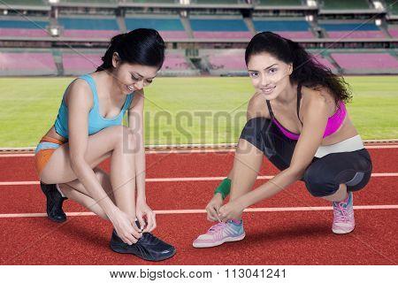Two Fitness Woman Preparing To Run