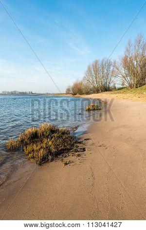 Pristine Sandy Beach Along A Wide River