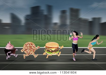 Two Young Woman Chased By Junk Food