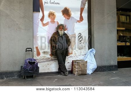 Milan, Italy - April 21, 2012: Homeless With Their Belongings Stands At The Poster.