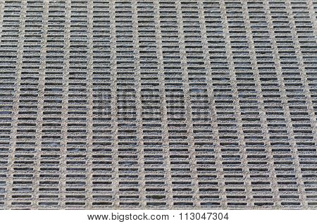 Gray Perforated Metal Mesh Background.