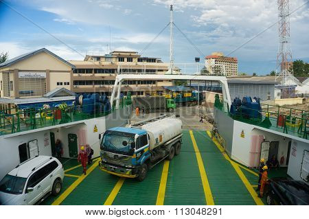 LABUAN FT, MALAYSIA - DEC 26, 2015: Ferry with vehicles on board in the morning on Dec 26, 2015.