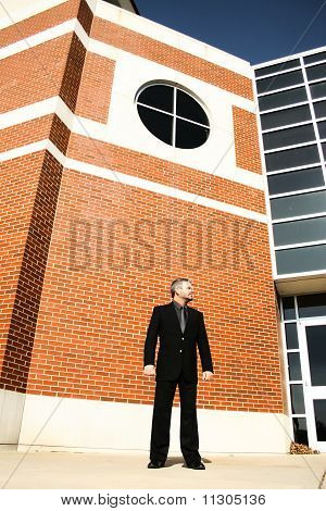 Business Man Standing Outside Building