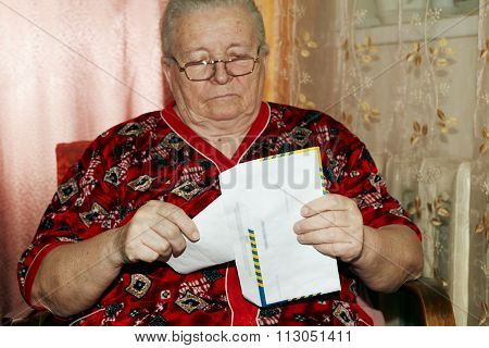 Elderly Woman And Open Letter