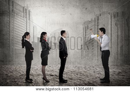 Business Leader Command His Subordinate Using Megaphone