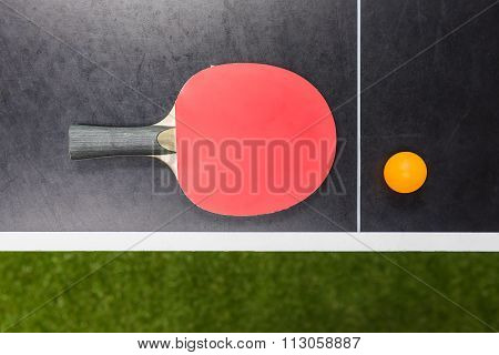 Table Tennis Racket With Ball On Black Table