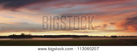 Dreamy Sunset Scenery With Fog Over The Fields